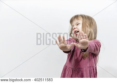 The Little Girl Threw Her Arms Forward In A Rejection Position. Human Emotions. Mock Up With Copy Sp