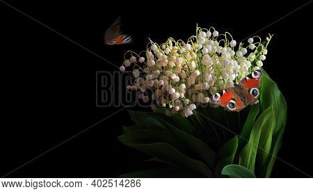 Bouquet Of Lilies Of The Valley And Bright Red Butterflies On Black. Copy Space
