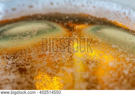 Close Up Of A Amber Beer Or Ale Foam Bubbles On The Top Of A Beer Pint Glass On A Sunny Day. Selecti