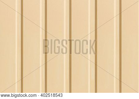 Texture Of The Wall With Yellow Vertical Siding Panels In Strips