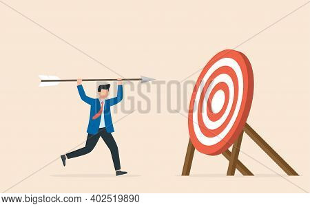 A Man With An Arrow In His Hands, Sets And Achieves Goals. Business Success Achievement. Smart Solut