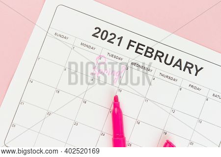 Groundhog Day Concept. The Word Spring Is Written On The Calendar On The Date 02 February. Pink Back
