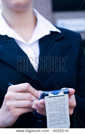 Businesswoman Using A Pda