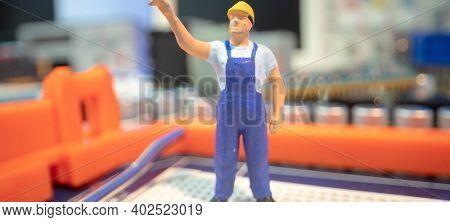 Miniature repair man mainboard, Miniature  worker team try to repair cpu on mainboard