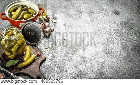 Marinated Cucumbers In A Bowl With And Herbs. On A Rustic Background.