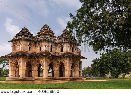 Hampi, Karnataka, India - November 5, 2013: Zanana Enclosure. Brown Stone Ruinous Lotus Mahal Buildi
