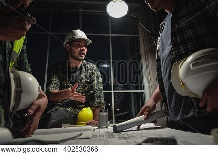Team Work, Engineers Discussion With Construction Team And Architects In Meeting Room At Night, Work