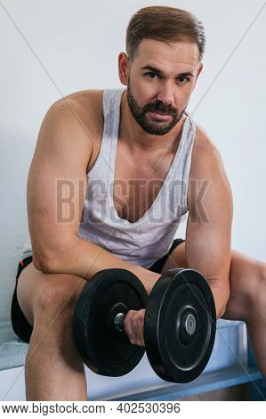 Man Making Biceps With A Dumbbell. Fitness In Gym, Sport And Healthy Lifestyle Concept