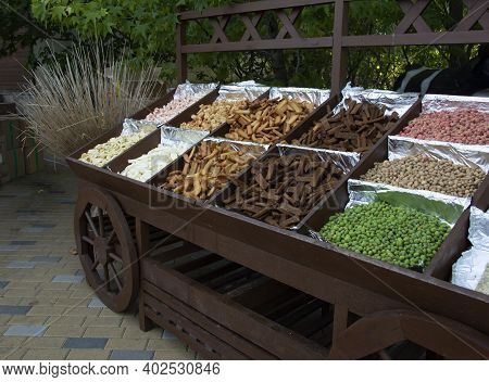 A Cart With Salty And Spicy Snacks - Croutons, Nuts For Beer At A Beer Festival