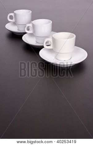 3 White Coffee Cups On Brown Table