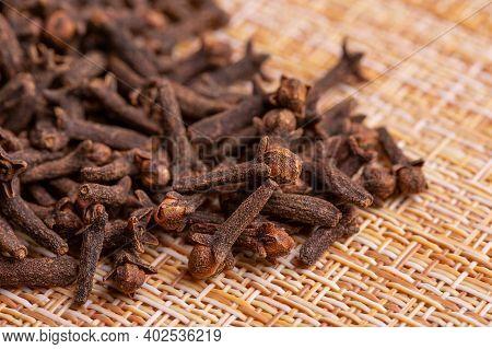 Close Up Of Carnation Seeds. Carnation Seeds. Carnation Seeds On A Wooden Background.