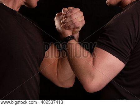 Brotherhood Of Men. Men Hold Hands Tightly. Strong Men.