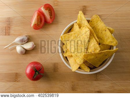 Nachos And Salsa Dip In A Bowl. Nachos With Tomato With Spices On A Wooden Background. Light Dishes.