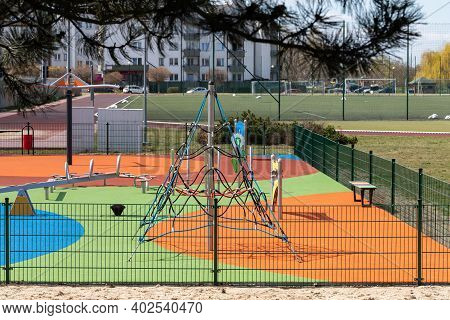 A Separate And Fenced Play Area For Children With A Safe, Colorful Surface. Childrens Outdoor Playgr