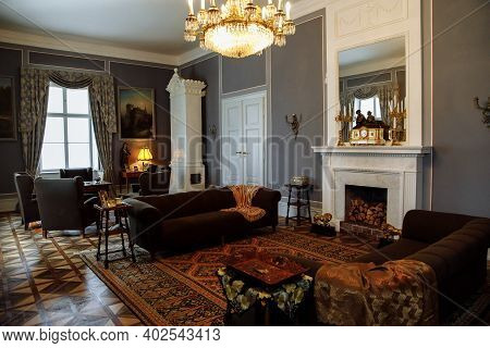 Horovice Castle Interior, Baroque Chateau, Carved Wooden Furniture In Guest Salon With Sofa And Armc