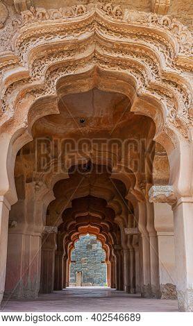 Hampi, Karnataka, India - November 5, 2013: Zanana Enclosure. Looking Through A Tunnel Of Arches In