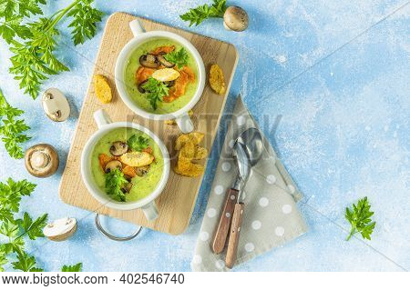 Creamy Cauliflower Soup With Toasted Bread Croutons On Blue Tabletop. Vegetarian Healthy Food Concep