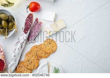 Appetizers Table With Differents Antipasti Set, On White Background, Top View  With Copy Space For T