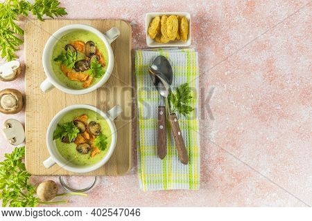 Healthy Delicious Potato Cauliflower Soup Puree With Carrot Chips And Croutons On A Pink Background,