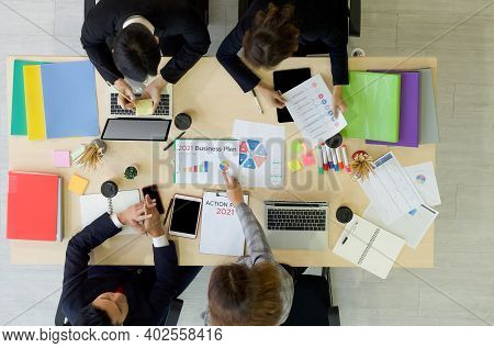 Business Executives Team Meeting 2021 Business Plan And Action Plan  In Modern Office With Laptop Co
