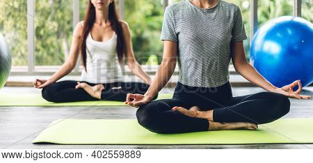 Portrait Of Sport Attractive People Woman In Sportswear Sitting Relax And Practicing Yoga Fitness Ex