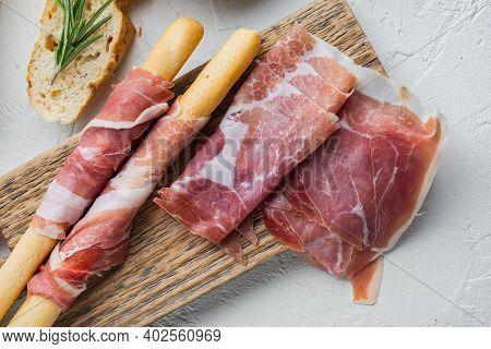 Delicious Serrano Ham Jamon Set, On White Background, Flat Lay