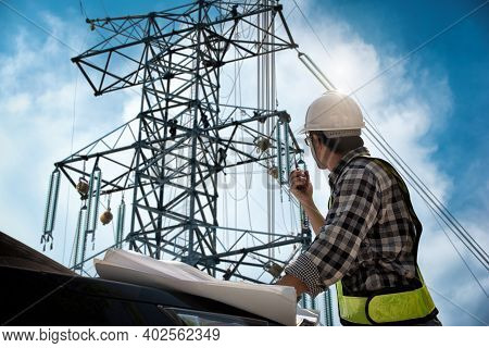 Electrical Engineer Control Wiring Electric Power On Steel Tower,  Electric Construction And Mainten