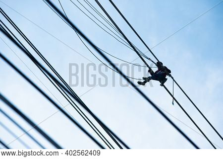 Worker Wiring On Electric Power Transmission Infrastructure. Electric Construction And Maintenance S