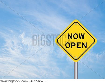 Yellow Transportation Sign With Word Now Open On Blue Sky Background