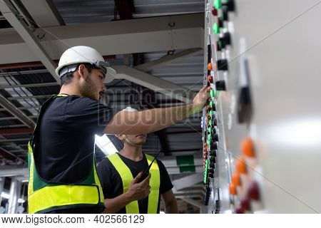 Electrical Engineer Team Working Front Hvac Control Panels, Technician Discussion And Training Daily