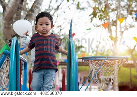 Asian Boy Portrait Tired Expression, Little Boy Playing At The Park On The Playground For Kids & Chi