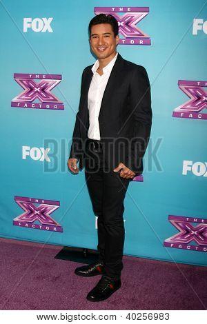 .LOS ANGELES - DEC 17:  Mario Lopez at the 'X Factor' Season Finale Press Conference at CBS Television City on December 17, 2012 in Los Angeles, CA