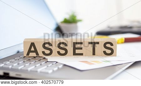Assets Wooden Cubes With Letters On A Laptop Keyboardwith Charts , Magnifier
