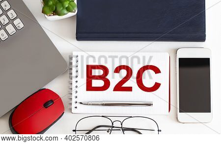 B2c Text On The Notepad,pen, Office Tools On White Background. Business Concept