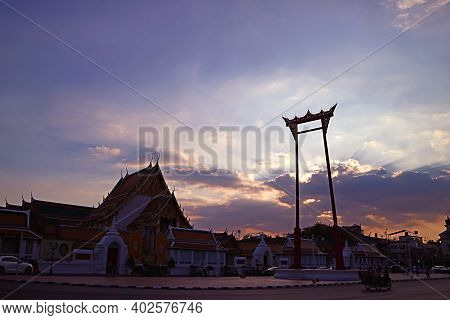 Incredible Evening View Of Sunsetwith Wat Suthat Thepwararam Temple And The Giant Swing Or Sao Ching