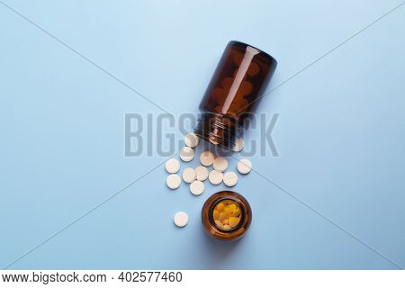 Medicine White Pills And Glass Pills Of Bottles