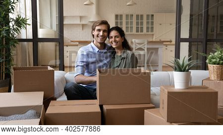 Portrait Of Happy Couple Renters Unpacking On Moving Day