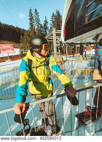 Portrait Of Man Snowboarder At Ski Pass Control Line