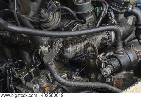 Car Repair, Car Service Concept. Fragment Of  Engine Compartment Of Diesel Truck. Engine, Exhaust Ma