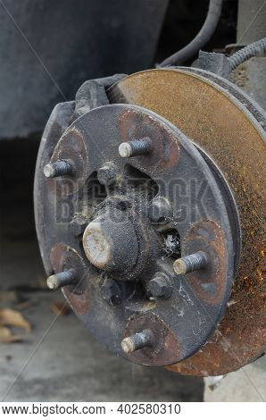 Close-up Of The Wheel Hub Without The Wheel. Front Wheel Hub With Studs And Rusted Brake Disc. Auto