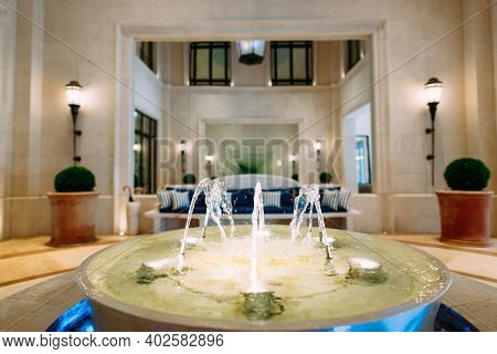 Fountain In The Lobby Of The Regent Hotel In Tivat, Montenegro. Decorative Fountain Bowl For Indoor