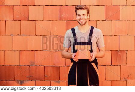 Carry Out Repairs. Worker Brick Wall Background. Building And Construction. Professional Repairman H