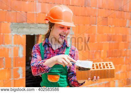 Lay Bricks. Engineer Teen Is Construction Worker. Professional Craftsman Or Workman. International W