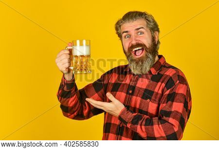 Alcohol Addiction. Relaxed Handsome Man Sipping Delicious Beer. Enjoying Glass Of Beer At Pub. Antic