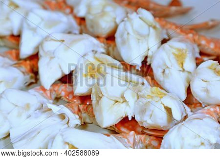 Closeup Row Of Mouthwatering Steamed Flower Crab Legs