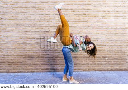 Funny Multiethnic Woman Carrying Her Best Friend Piggyback