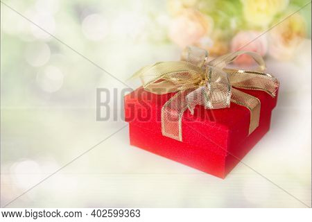 Gift Box And Flower On On Table With Blur Bokeh Background, Love And Romance, Present In Celebration