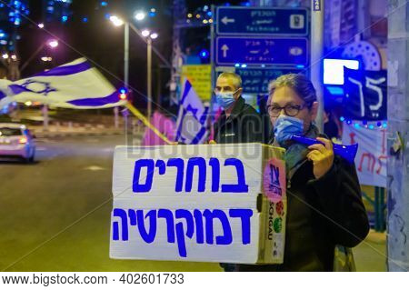 Haifa, Israel - January 09, 2021: Protestors With Flags And Signs Take Part In The Black Flags Prote