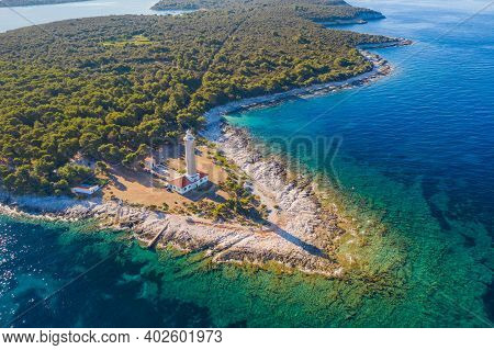 Old Lighthouse Of Veli Rat On The Island Of Dugi Otok, Adriatic Sea Horizon In Background, Beautiful