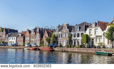 Maarssen, Netherlands - August 25, 2018: Village Landscape As Seen From The River Vecht Of The Old D